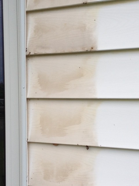 Stained White Vinyl Siding Beneath The Shutters