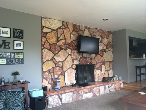 I would love your thoughts and ideas on what to do with our fireplace wall.  I am considering painting the whole thing a dark grey just like the wall