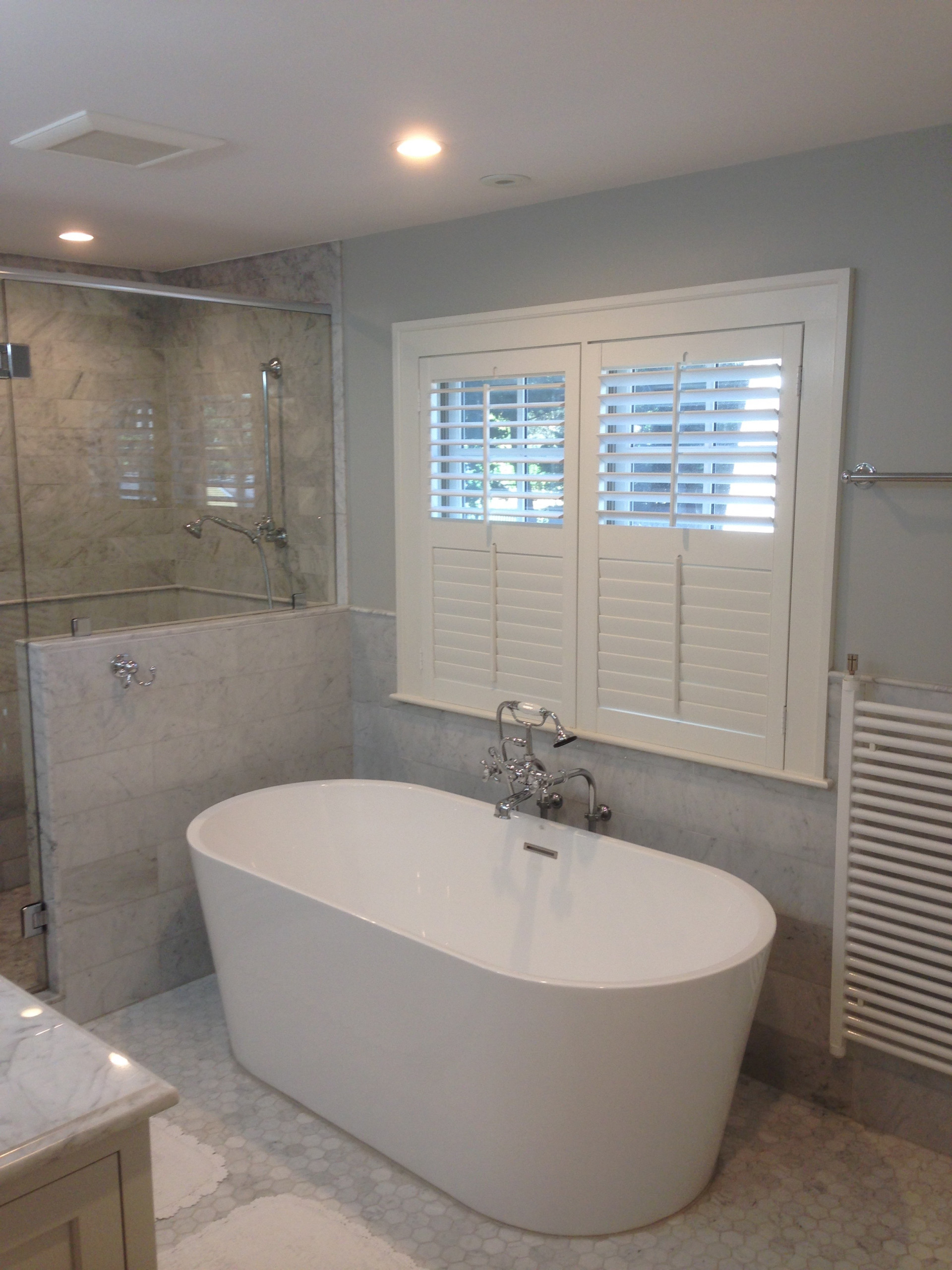 soaking tub below windows