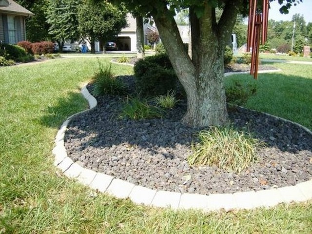 Stone edge around tree and shurbs for Landscaping rocks under trees