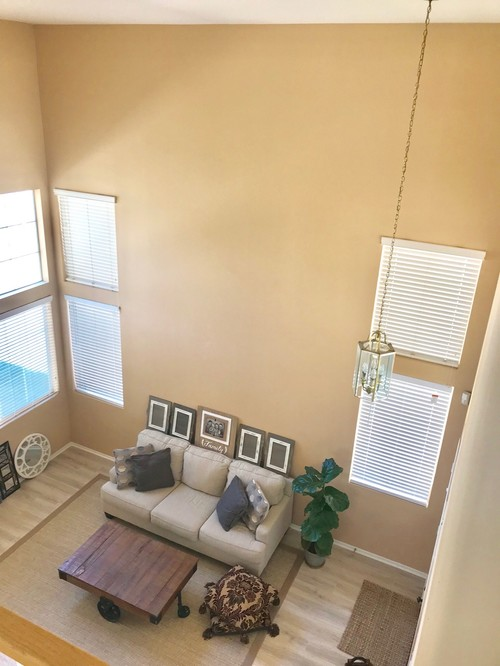 Help! How to decorate a high ceiling living room.