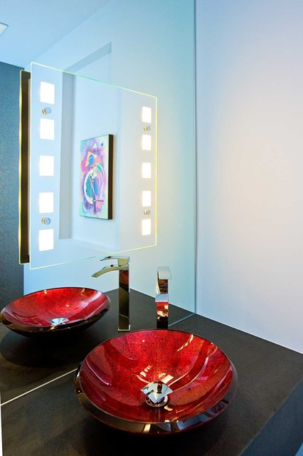 Elegant Powder Room With Red Sink And Lighted Mirror