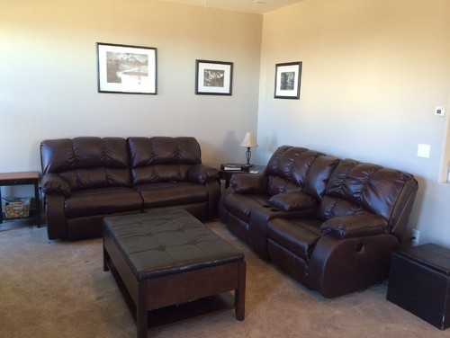 stadium seating couches living room.  Leather reclining couch and love seat