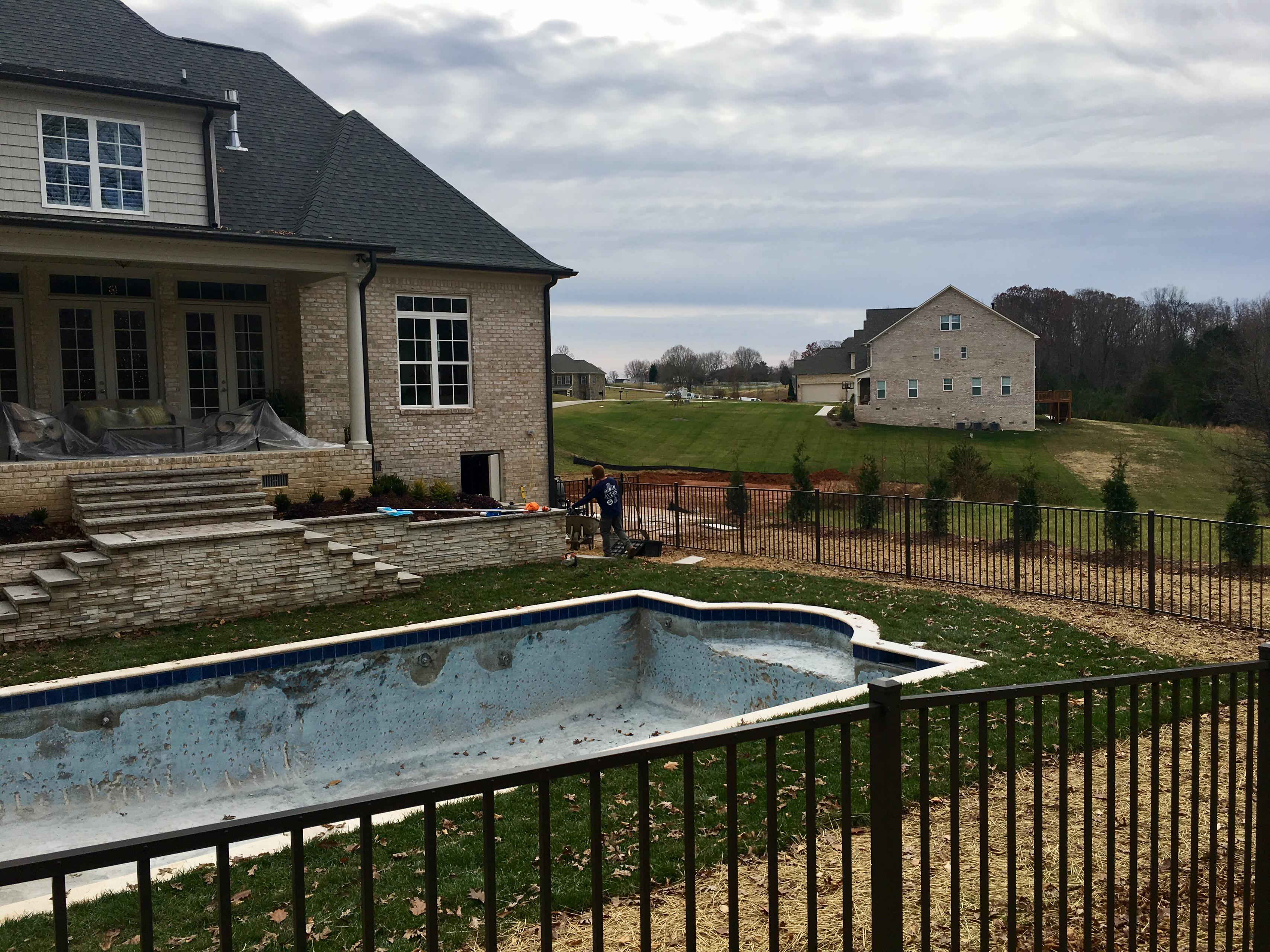 BEFORE PHOTOS:  Pool with firepit, english garden, large patio areas and column