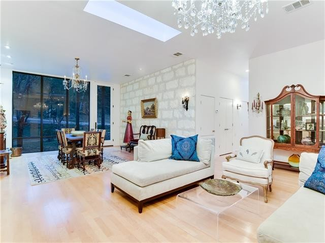 Living room - modern living room idea in Austin
