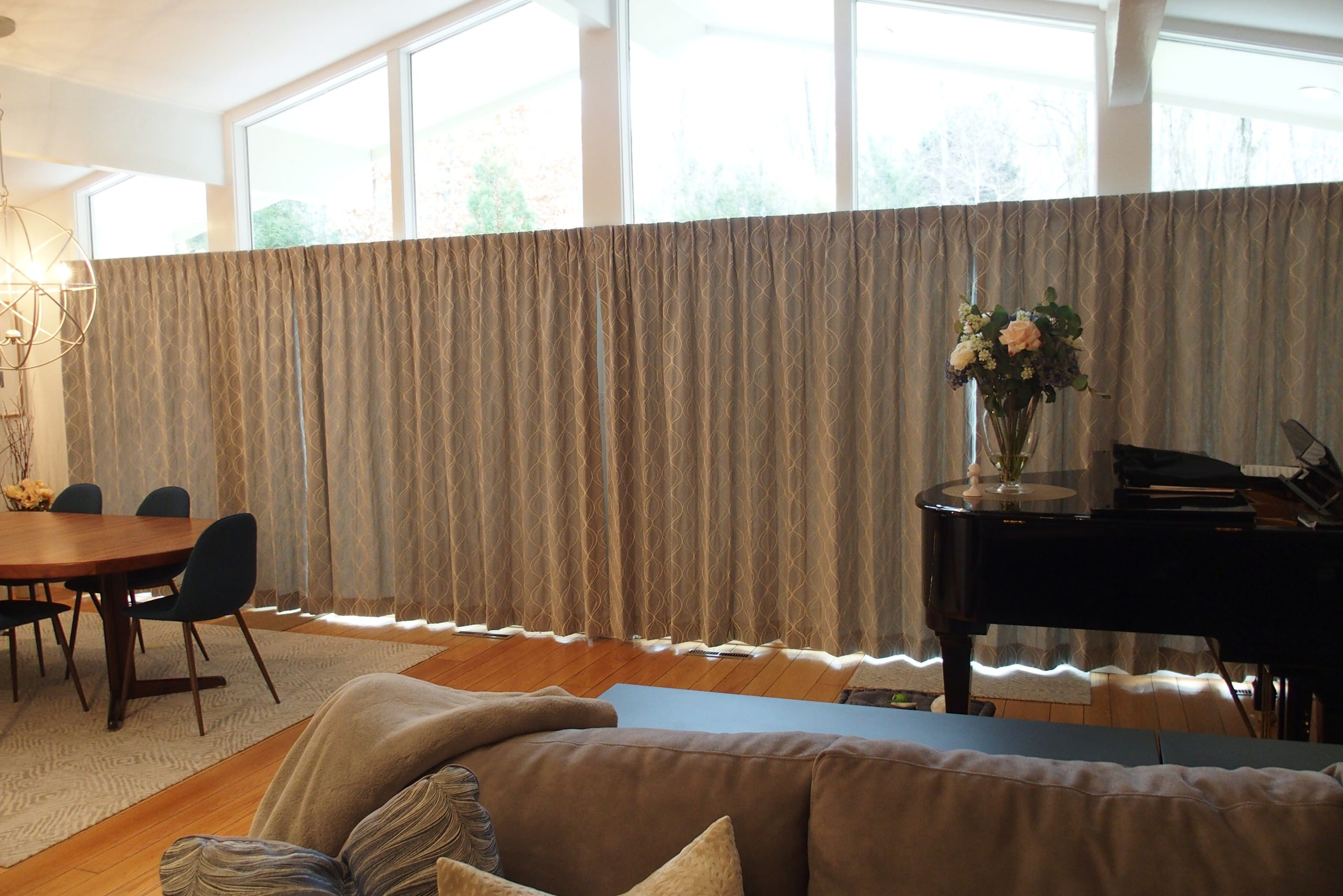 Draperies for a dining room and living room in a contemporary home