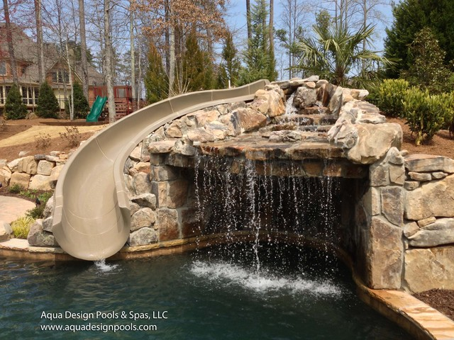 Free form pool with slide and grotto craftsman pool for Pool design by laly llc