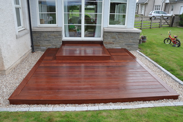Simple Square Deck Provides A Practical Entrance And An