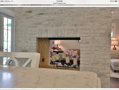 I would like to whitewash my brick fireplace to look like this photo.  Any suggestions on how to get this look?