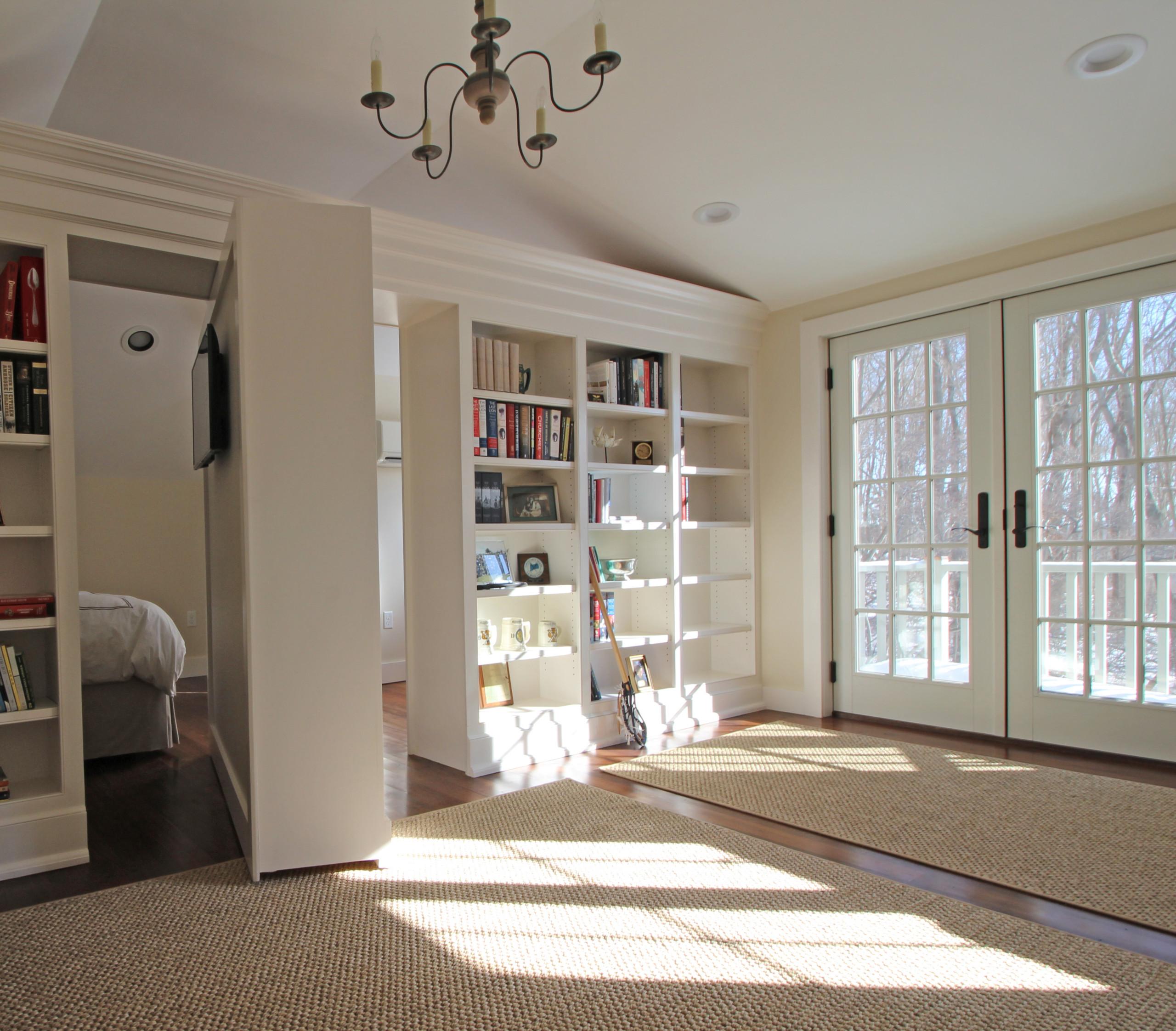 Rotating bookshelf wall