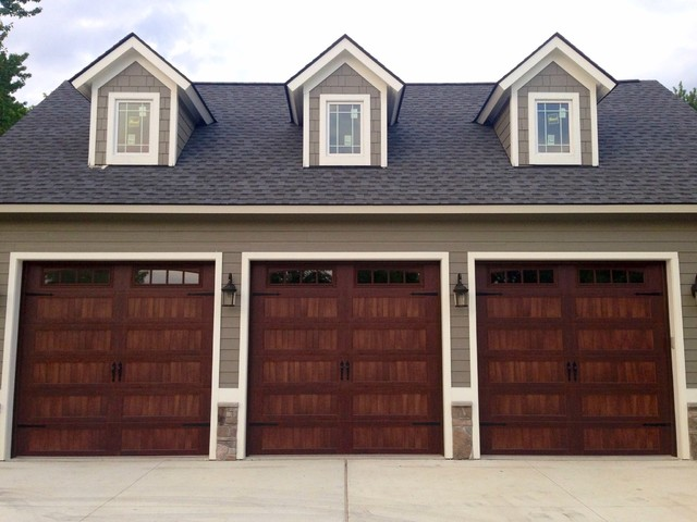 Faux wood garage doors traditional garage detroit by premier door service for Premier garage doors
