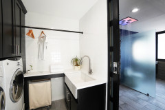 Loads of Function in a Classic Black-and-White Laundry Room