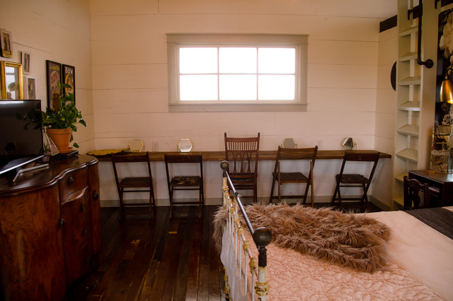 Inspiration for a large cottage master dark wood floor and brown floor bedroom remodel in Austin with white walls