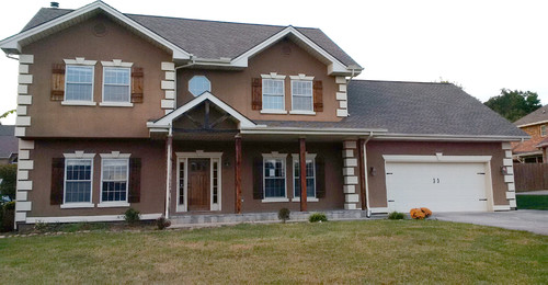 Brick hardie engineered stone or all three for Brick houses with stone accents