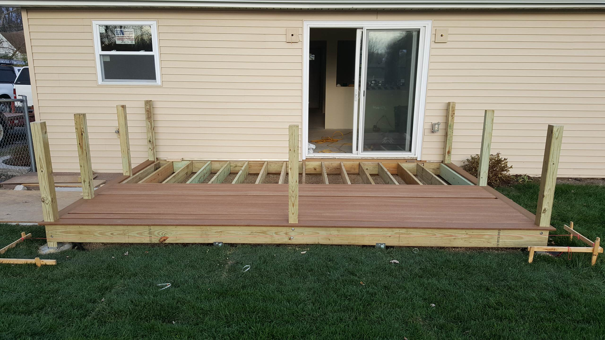 Composite decking, new siding, windows and sliding glass door