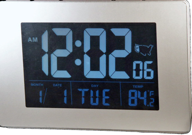 "Atomic Clock With 1.75"" White Time Numbers."