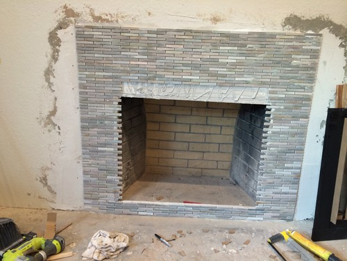 We ended up ordering excess mosaic tile when we started working on our fireplace surround. We have the tile put up on the wall already. From end to end