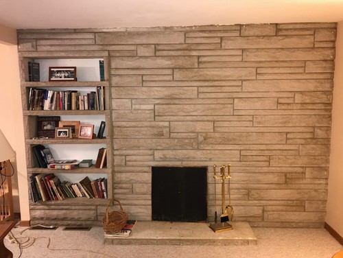 limestone fireplace wall in living room ditch or remodel