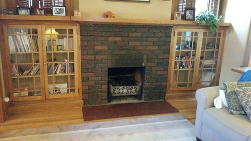 We are planning to install a wood burning insert into our existing masonry fireplace.  Building code requires that our hearth be extended about 3 inches.  Finding a match for our existing hearth tile is unlikely and the red square tile isn