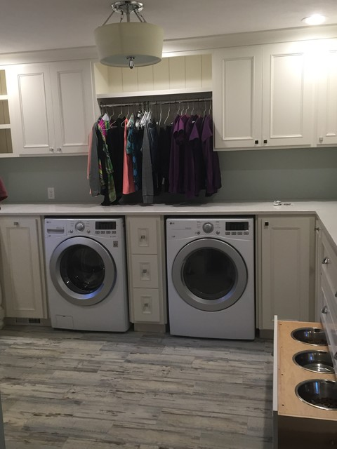 Example of an eclectic laundry room design in Other
