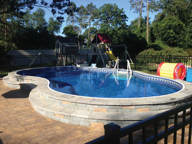 Metric freeform pool semi inground installation new york by radiant pools for Best semi inground swimming pools