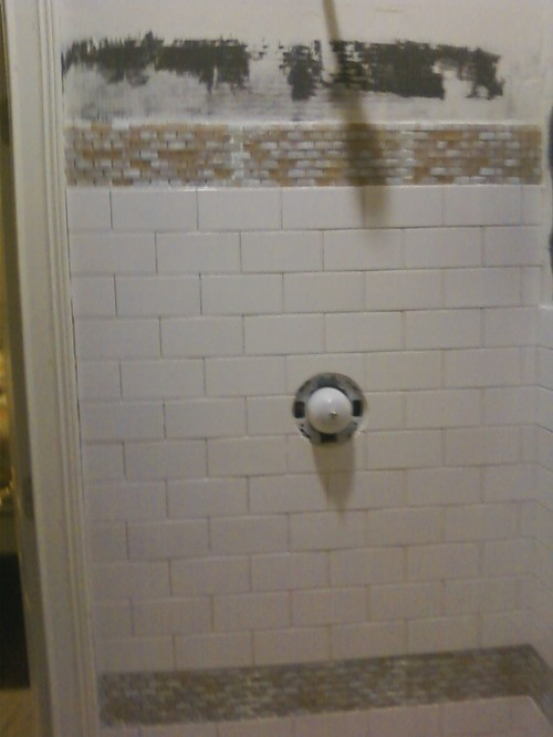 Glass Mosaic Tile Installed W Paper Against Shower Wall