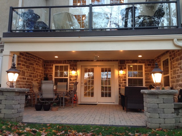 Columbus second story deck over patio creates dry space for 2 story decks and patios