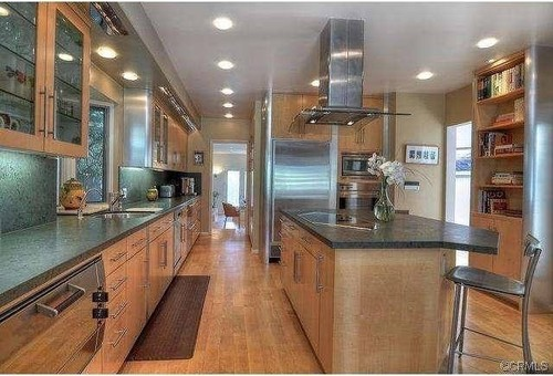 Should we replace engineered hardwood floor in our kitchen, and if so,