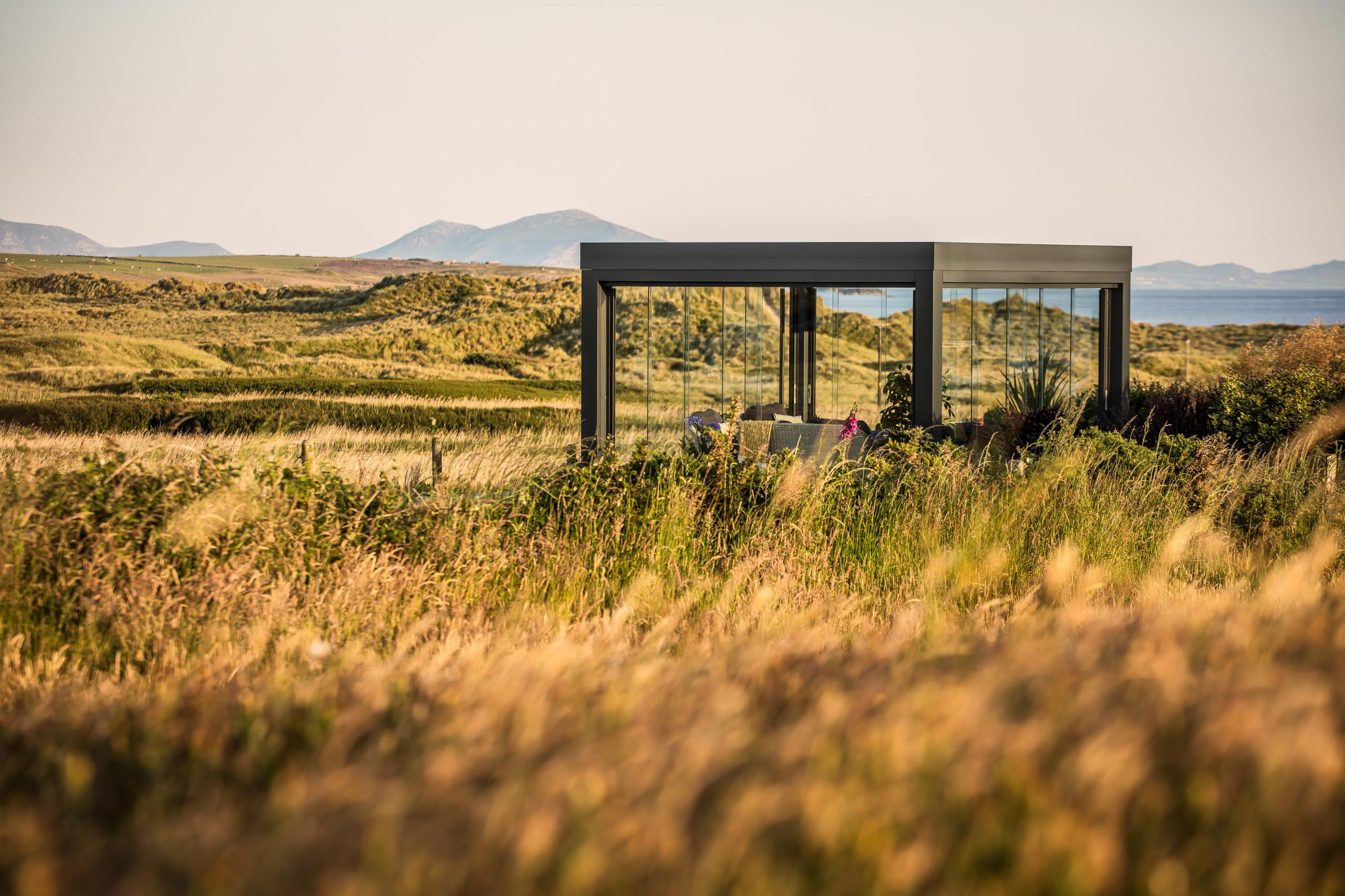 Freistehendes Terrassendach - Glashaus in den Dünen
