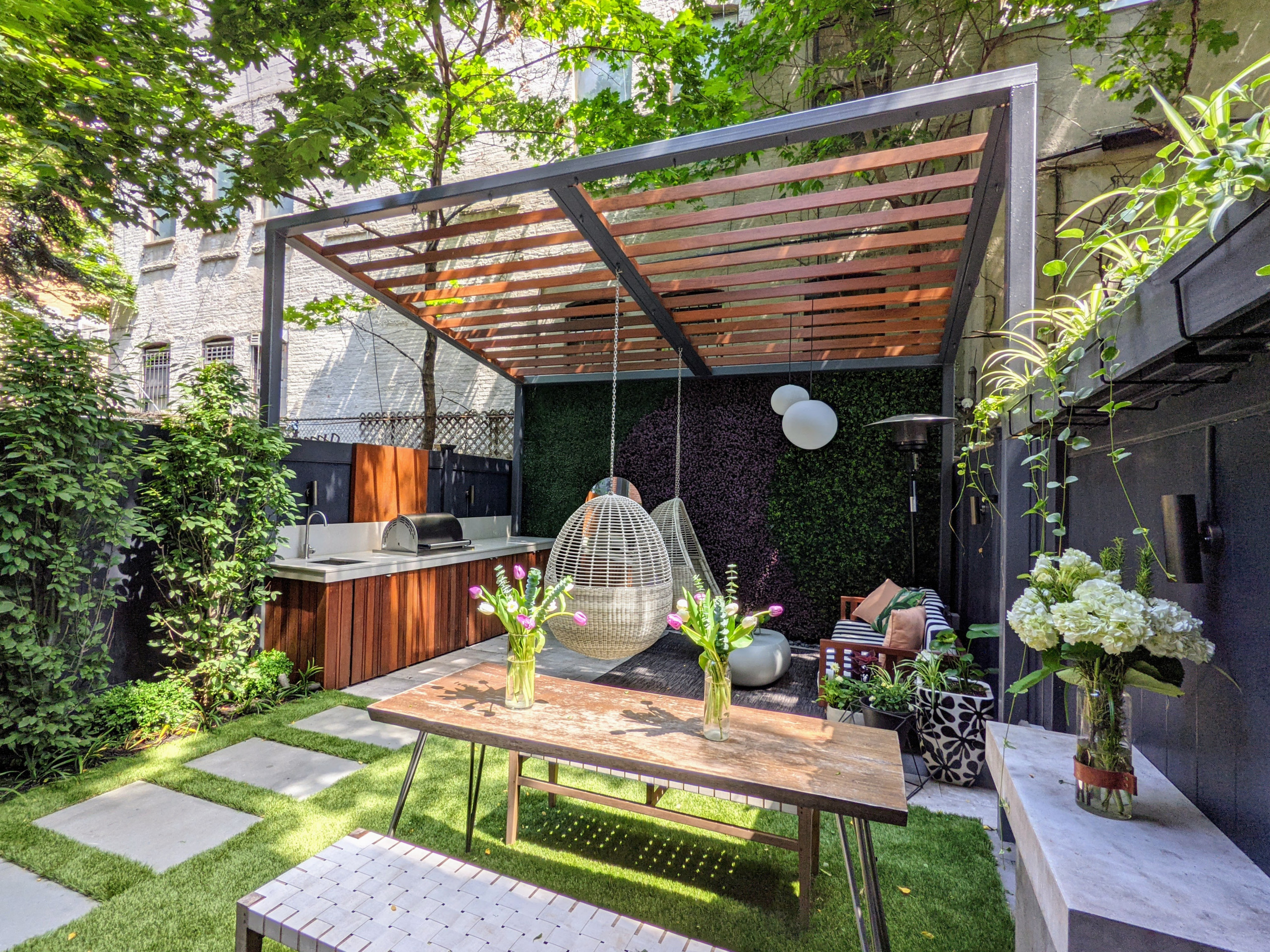 Pergola and kitchen are focal items.