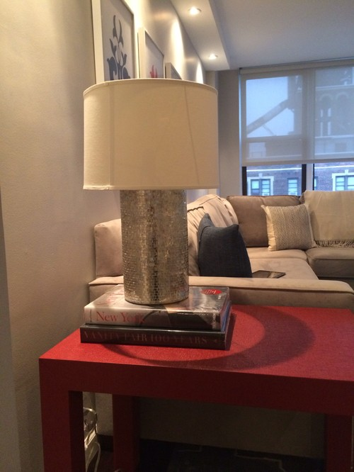 putting a lamp on coffee table books