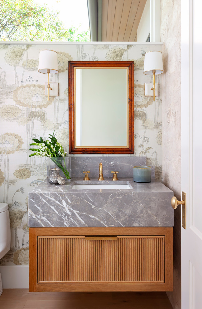 Transitional powder room photo in Austin