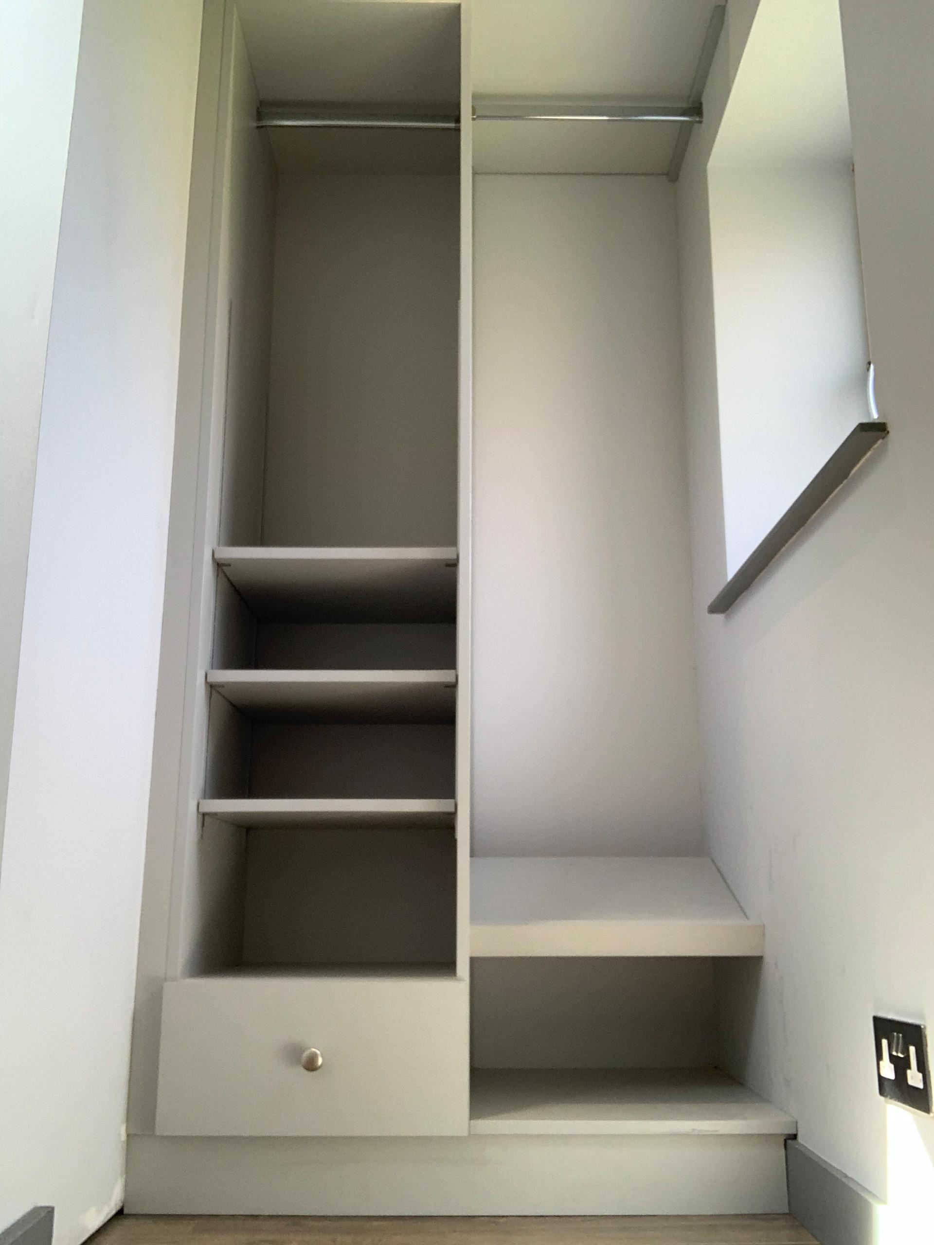 Grey walk in wardrobe