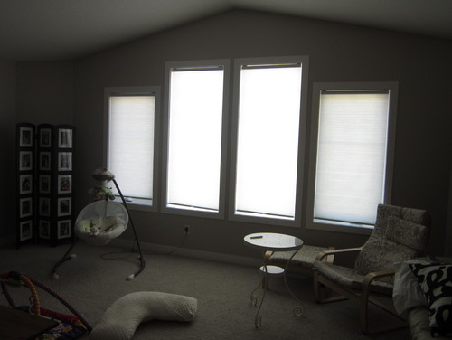 How should I hang curtains for windows that are different lengths?