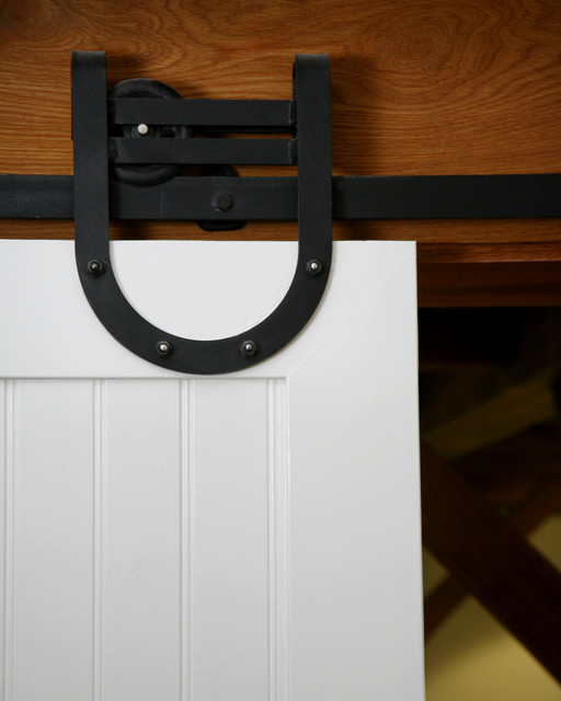 Beautiful barn door hardware on custom door. farmhouse