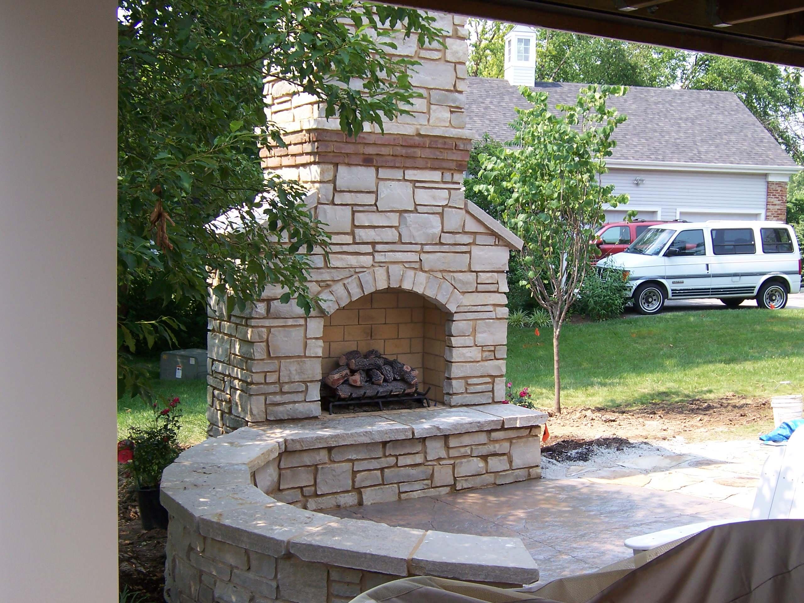 Lake St Louis, Missouri Outdoor Stone Masonry (Gas) Fireplace with Brick Banding
