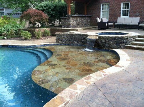 Here is a flagstone veneered water lounge also called a for Pool design with sun shelf