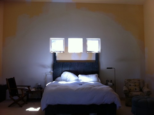 above bed lighting. window treatments wall color lighting above bed