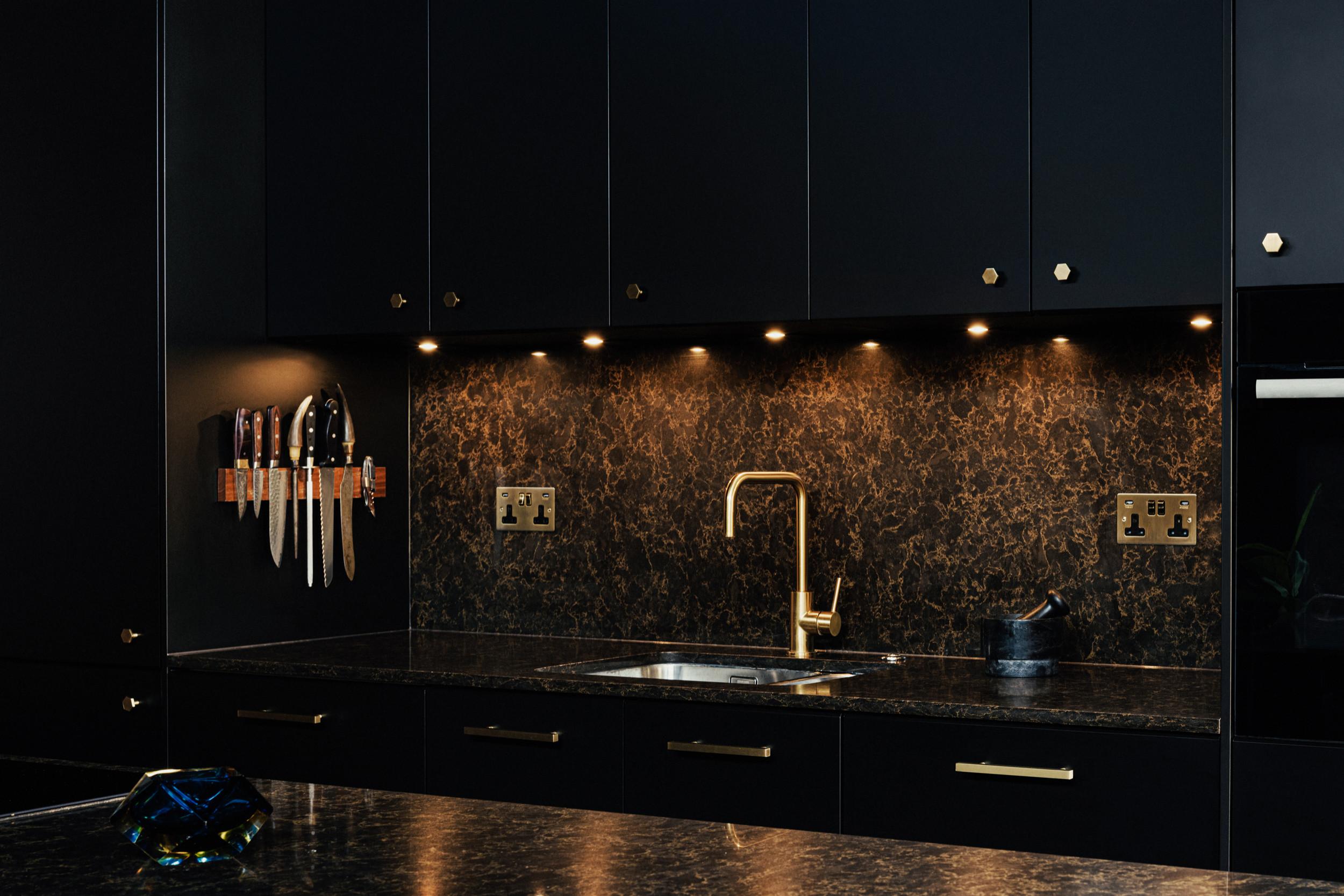 Black kitchen with Brass details