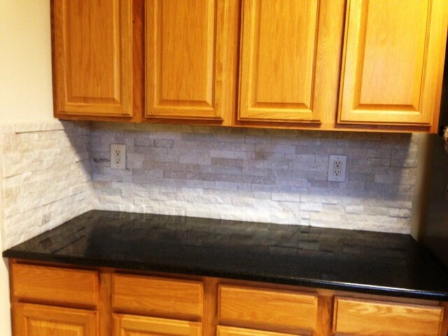 Black pearl granite on medium wood cabinets traditional Black pearl granite