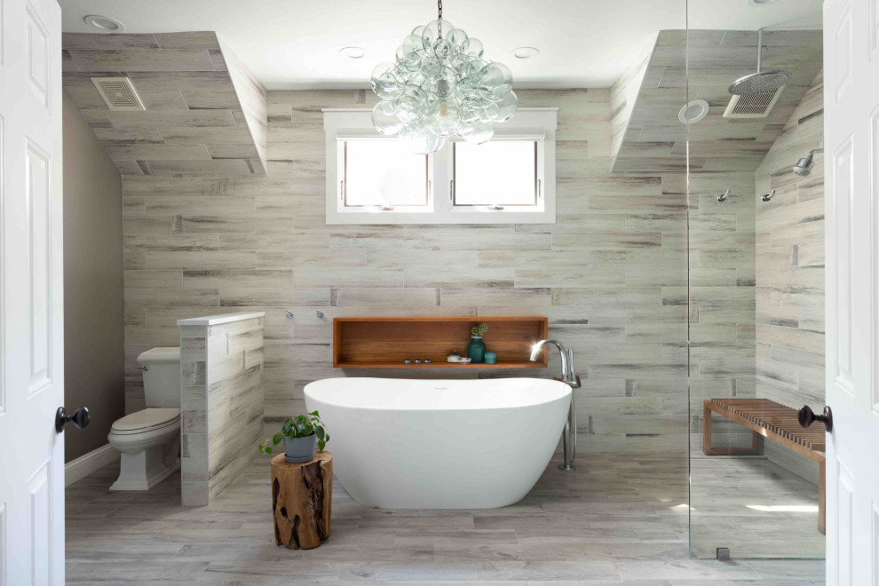 Mid-sized trendy master multicolored tile and porcelain tile porcelain tile, beige floor and double-sink bathroom photo in Chicago with furniture-like cabinets, gray cabinets, a two-piece toilet, beige walls, a drop-in sink, quartz countertops, beige countertops and a freestanding vanity