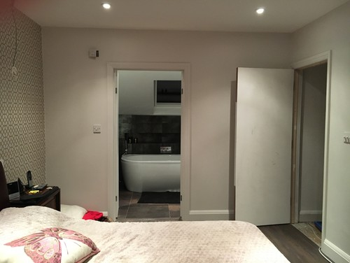 There is something wrong with the room and I don t know what it is  It  opens to a bathroom that had metallic copper brown tiles  I am not sure  what to do. My new bedroom lacks warmth