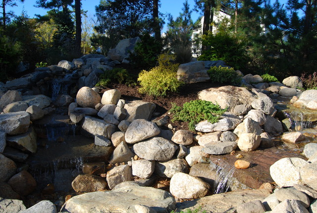 Pondless waterfall and patio for Passarelli custom homes