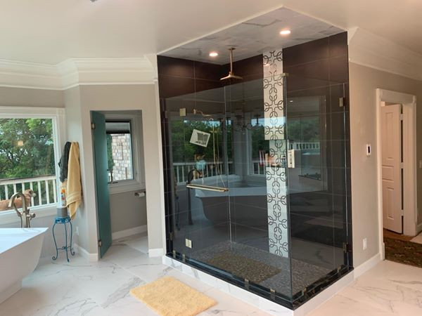 Frameless Shower Glass with Rainfall Shower Head and Decorative Tile