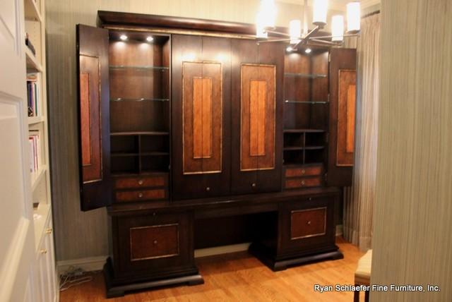 cherry displaydesk cabinet features bi fold pocket doors accent lighting and cabinet accent lighting