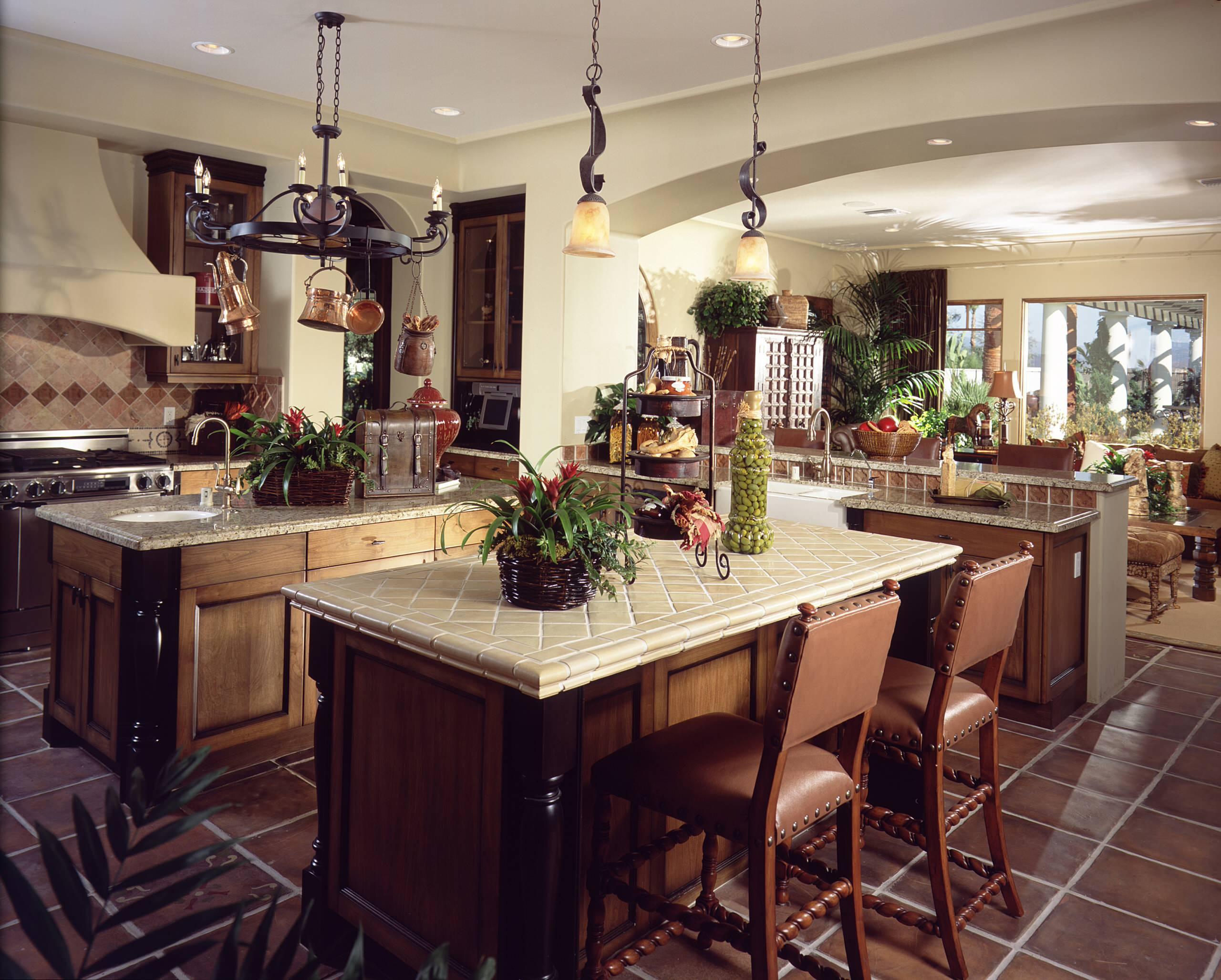 Elegant Medium Kitchen with mixed media countertops