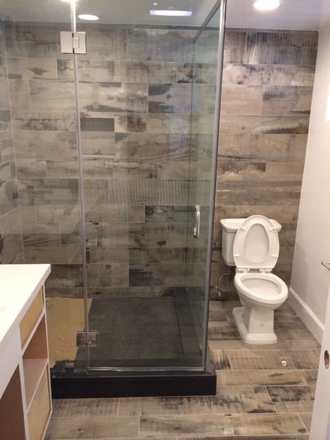 Reclaimed wood look bathroom shower for Cabin shower tile ideas