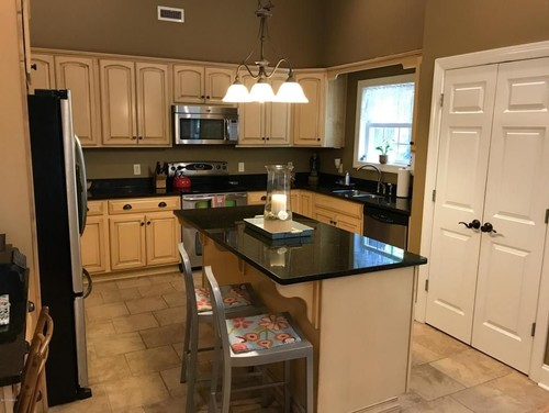 need paint color ideas for kitchen with buttercream cabinets.