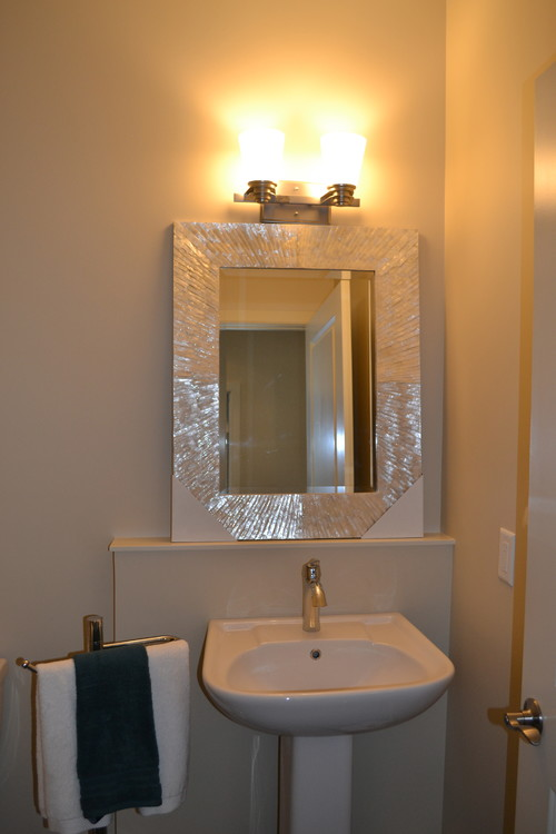 powder room wall lights moving a light in the powder room how hard is this really