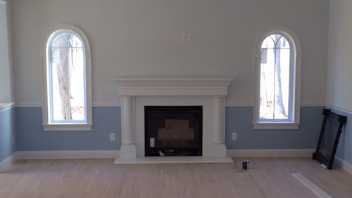We are moving to a newly constructed home and the family TV is supposed to go on the wall above the gas fireplace in the family room (cable hookup is there already). The fireplace mantle is not deep enough to put a cable box on it
